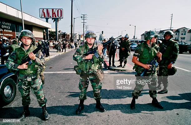 Armed National Guard soldiers hold a line in front of a post office in South Central LA Many South Central residents are expecting their monthly...