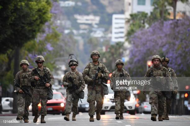 Armed National Guard soldiers patrol on Hollywood Blvd June 1 2020 in Hollywood California as peaceful protests and looting continue in Los Angeles...