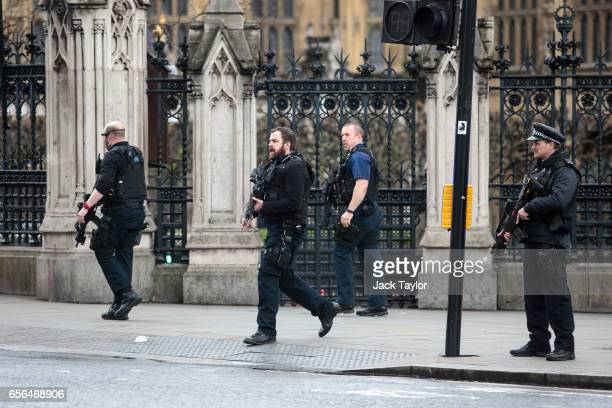Armed officers attend to the scene outside the Houses of Parliament on March 22 2017 in London England A police officer has been stabbed near to the...
