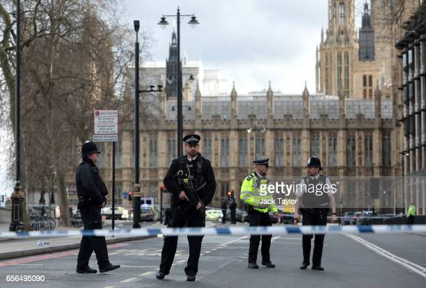 Armed officers attend to the scene outside Westminster Bridge and the Houses of Parliament on March 22 2017 in London England A police officer has...