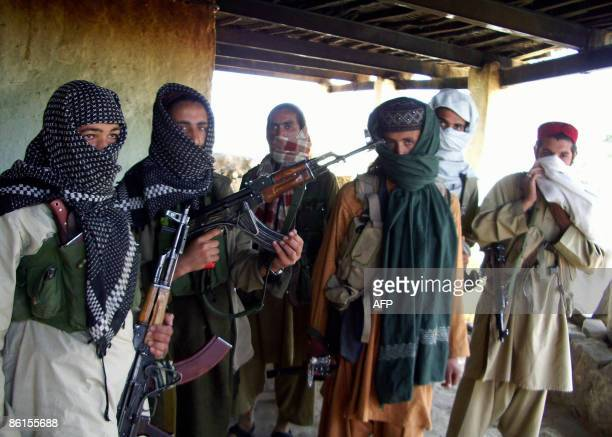 Armed Pakistani Taliban gather at a hideout in the semiautonomous tribal district of Orakzai on April 22 2009 Pakistan helicopter gunships raided...