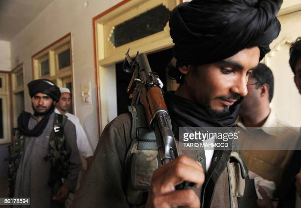 Armed Pakistani Taliban gather during a minijirga or traditional council between Talibans and residents in the Buner district of the troubled Swat...