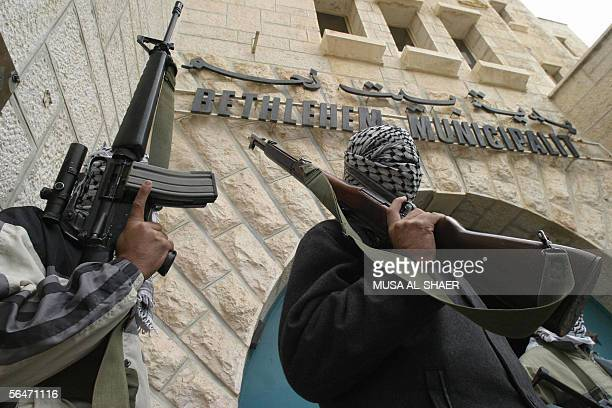 Armed Palestinian AlAqsa Martyrs Brigades gunmen stand outside Bethlehem's Municipality building 20 December 2005 The Aqsa militants briefly occupied...