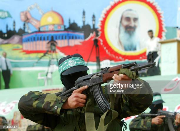 Armed Palestinians from the military wing of the Islamic resistance movement, Hamas, wield their AK-47 rifles, as they demonstrate martial arts...