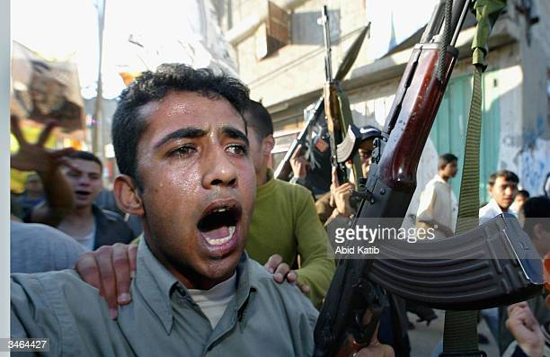 Armed Palestinians march in support of Palestinian leader Yasser Arafat on April 242004 in the Nussirat refugee camp Gaza strip Palestinian leader...