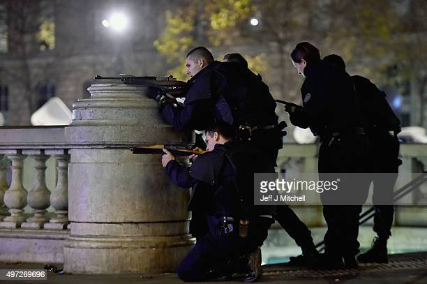 Armed police are deployed and take aim in Place de la Republique during a false alarm incident on November 15 2015 in Paris France France is...