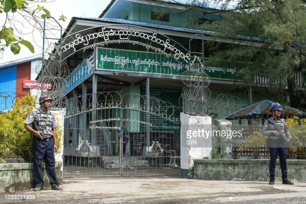 Armed police are posted at the entrance of a school in Sittwe, capital of western Rakhine State on June 1, 2021. - Schools in Myanmar opened on June...