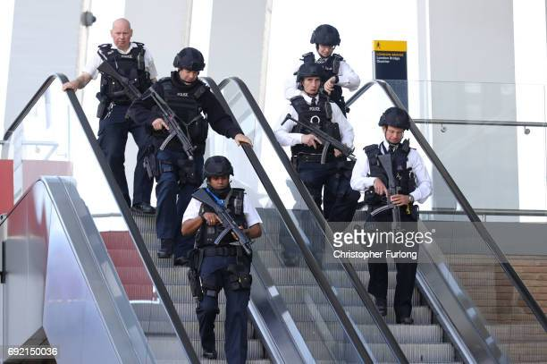 Armed police are seen at London Bridge near the scene of last night's terrorist attack on June 4 2017 in London England Police continue to cordon off...