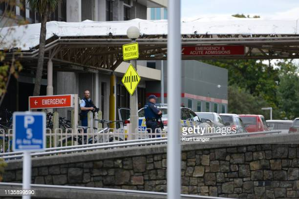 Armed police are seen at the entrance of Christchurch hospital on March 15 2019 in Christchurch New Zealand Four people are in custody following mass...