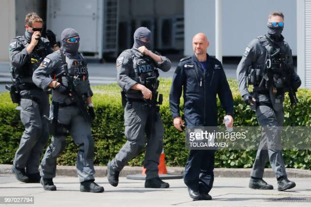 Armed police are seen on the tarmac at Stansted Airport north of London on July 12 ahead of the arrival of US President Donald Trump on Air Force One...