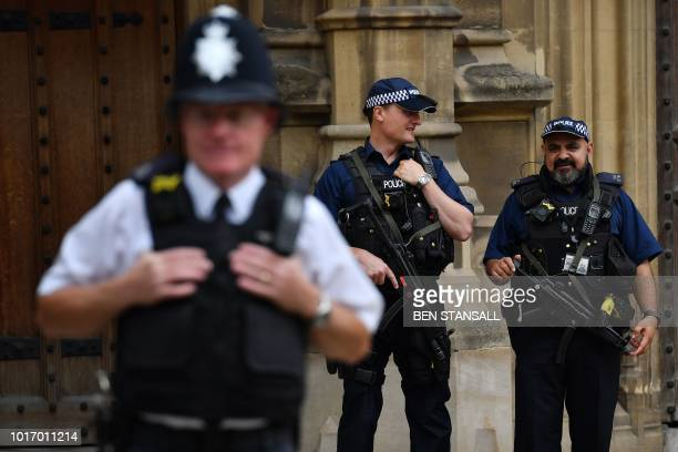 Armed police are seen outside the Houses of Parliament in central London on August 15, 2018 close to the scene of a suspected terror attack on August...