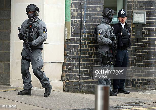 Armed police await the arrival of US President Barack Obama at the Globe Theatre on April 23 2016 in London England The president made an...