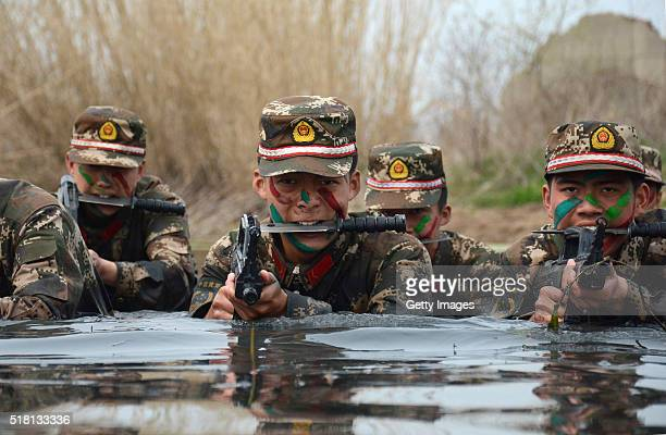 Armed police commandos train in water on March 30 2016 in Chuzhou Anhui Province of China
