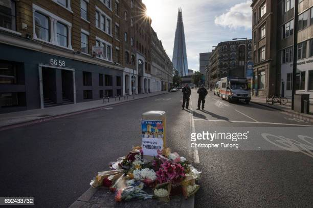 Armed police continue to guard the cordon around around Borough Market on June 5 2017 in London England Police have made a number of arrests after...
