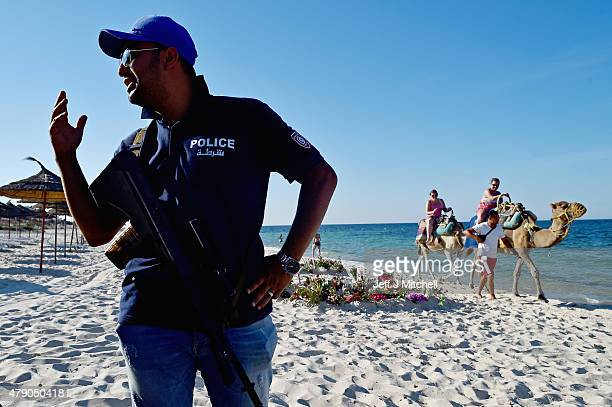 Armed police continue to patrol Marhaba beach in Sousse where 38 people were killed in last Fridays terror attack on June 30 2015 in Sousse Tunisia...