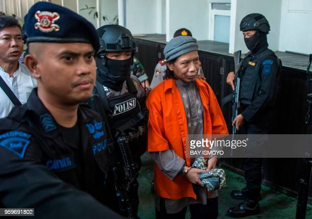 TOPSHOT Armed police escort Aman Abdurrahman leader of the Islamic State group linked militant outfit Jamaah Ansharut Daulah to a court hearing for...