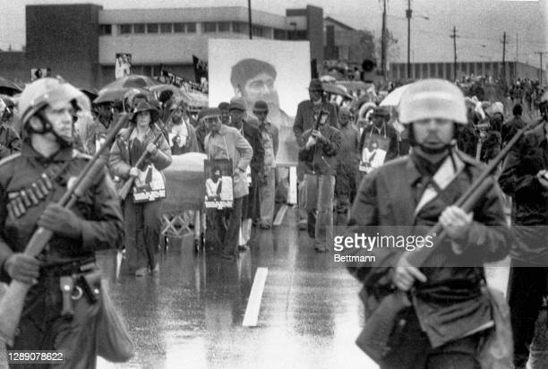 Armed police escort at a funeral march for five Communist Workers Party members killed on 11/3 in a shootout with Ku Klux Klansmen and Nazis. The...