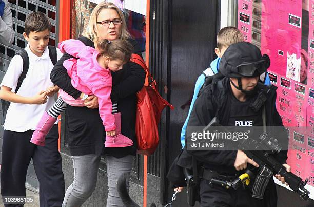 Armed police escort people from a building during a ongoing incident at Dumbarton Road on September 10 2010 in Glasgow Scotland Armed response units...