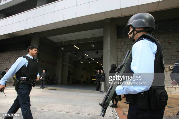 Armed police force on alert for security outside High Court in Admiralty when defendant Kwai Pinghung who applies for appeal is brought to court in...