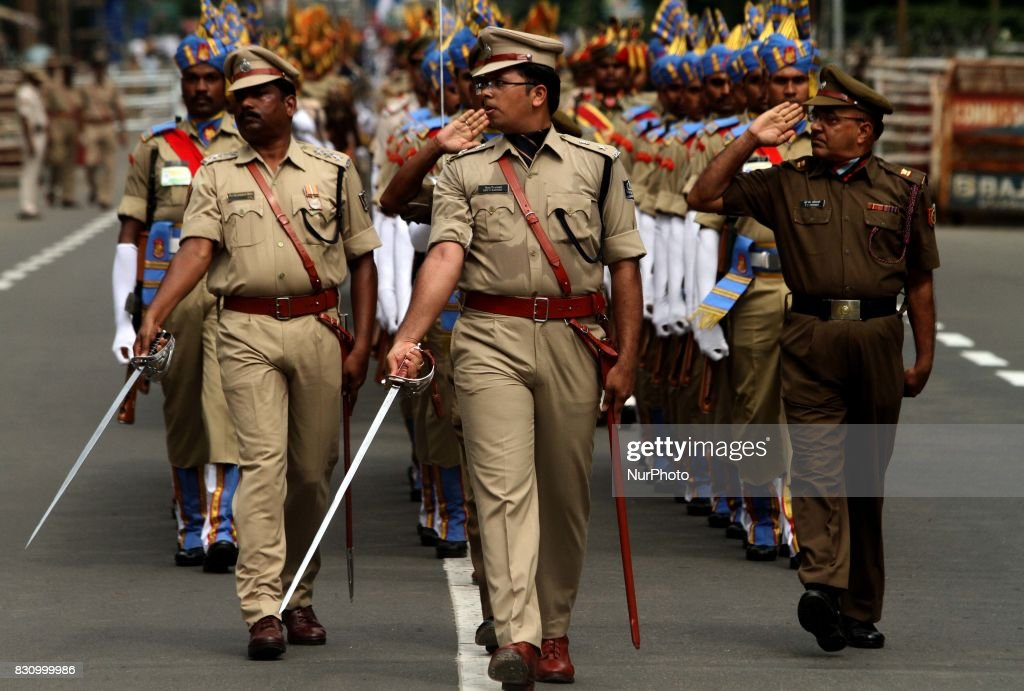 Armed Police force, students of National Credit Corps and Scout Guide look in their ceremonial dress as they march past on the final and full dress rehearsal ahead of the 70th Independence Day celebration in the eastern Indian state Odisha's capital city Bhubaneswar on 13 August 2017.