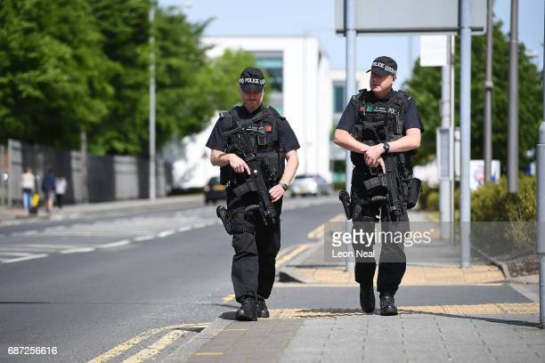 Armed police guard Greater Manchester Police station as a flag flies at halfmast in the background on May 23 2017 in Manchester England Prime...