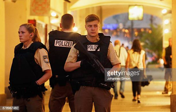 Armed police guard the downtown pedestrian zone near Marienplatz square following a rampage shooting in the city on July 22 2016 in Munich Germany...