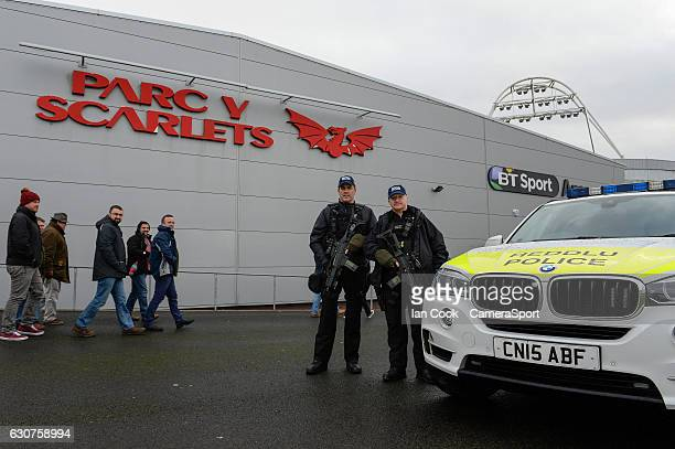 Armed Police guard the entrance to the Parc Y Scarlets during the Guinness PRO12 Round 12 match between Scarlets and Cardiff Blues at Parc y Scarlets...