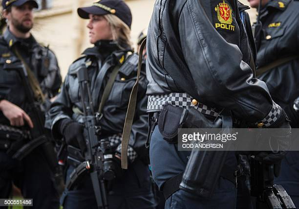 Armed police guard the Nobel institute ahead of a press conference with the Nobel Peace Prize laureates the Tunisian National Dialogue Quartet in...
