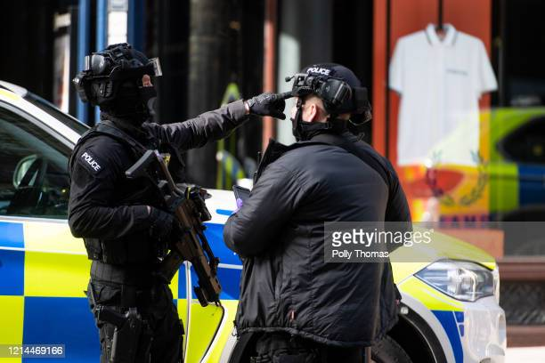 Armed police in the city centre on March 20 2020 in Cardiff United Kingdom