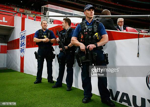 Armed Police keep watch during the France training session at Wembley Stadium on November 16 2015 in London England