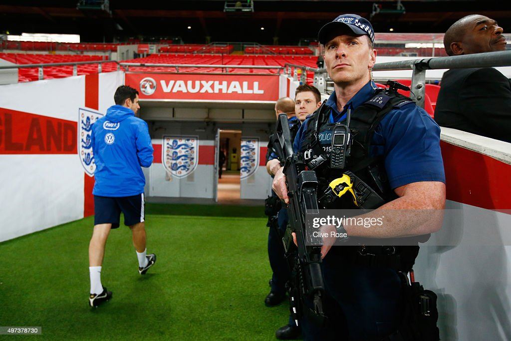 Armed Police keep watch during the France training session at Wembley Stadium on November 16, 2015 in London, England.