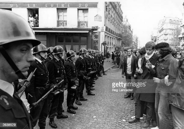 Armed police line up to confront students in the 5th arrondissement during the Paris riots of May 1968