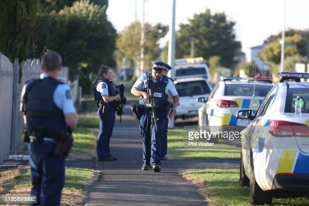 Armed police maintain a presence outside the Masijd Ayesha Mosque in Manurewa on March 15 2019 in Auckland New Zealand Four people are in custody...