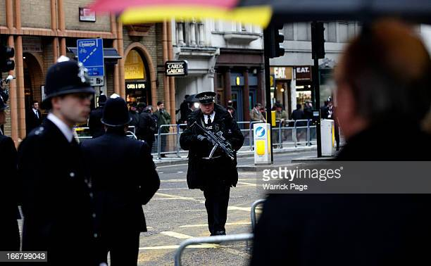 Armed police man the streets during the funeral of former British prime minister Baroness Thatcher on April 17 2013 in London England Dignitaries...