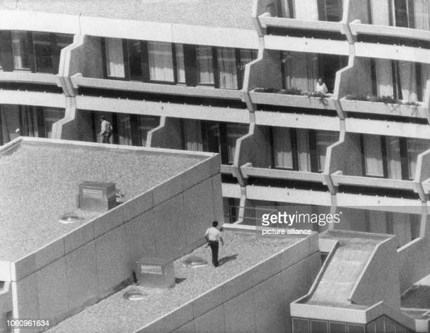Armed police men guard the Israeli team's accomodation in the Olympic Village on the 5th of September in 1972 from a balcony and the roof. Arabic...
