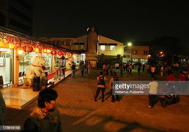 Armed Police Officer securing the locations around bomb explosions in Ekayana Buddhist Temple District Duri Kepa Tanjung Duren on August 4 2013 in...