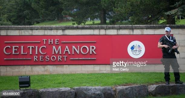 A armed police officer stands guard outside the main gates at the Celtic Manor Resort ahead of the Nato Summit 2014 that is being held in South Wales...