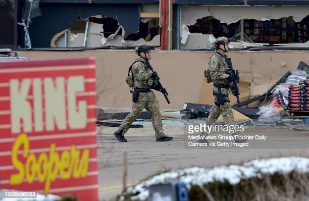 March 22:Armed police officers are seen outside broken windows at King Soopers on Table Mesa Drive in Boulder after reports of shots fired on Monday,...
