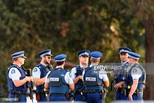 Armed police officers are seen prior to the first burials of victims at Memorial Park Cemetery on March 20 2019 in Christchurch New Zealand 50 people...