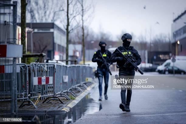 """Armed Police officers arrive at 'The Bunker', an extra secure court in Amsterdam Osdorp on April 7 for the continuation of """"The Marengo Trial"""" in..."""