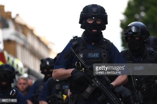 Armed police officers arrive at The Shard in the London Bridge quarter in London on June 4 following a terror attack Fortyeight people have been...