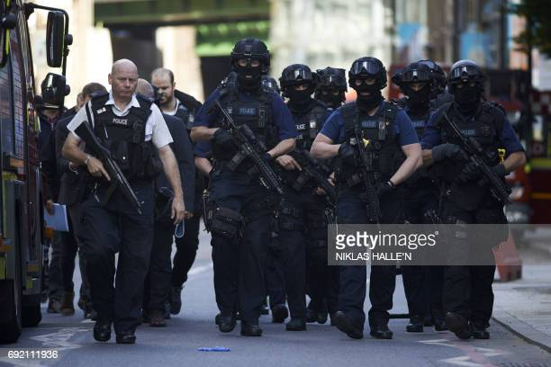 TOPSHOT Armed police officers arrive at The Shard in the London Bridge quarter in London on June 4 following a terror attack Fortyeight people have...