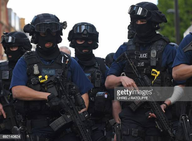 Armed police officers arrive at The Shard in the London Bridge quarter in London on June 4 following a terror attack Seven people were killed in a...