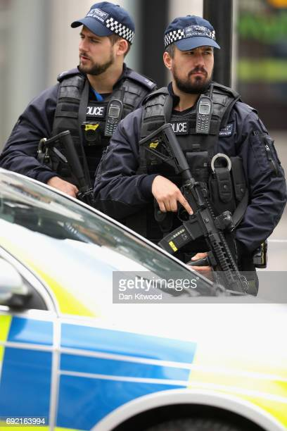 Armed police officers at a cordon on London Bridge following last night's terrorist attack on June 4 2017 in London England Police continue to cordon...