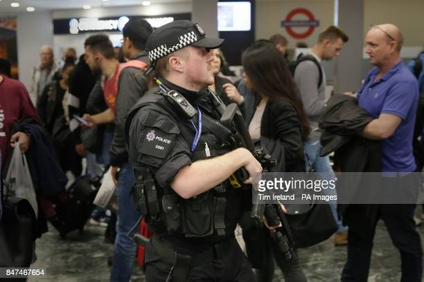 Armed police officers at Euston Station London after a terrorist incident was declared following a blast which sent a quotfireballquot and a quotwall...