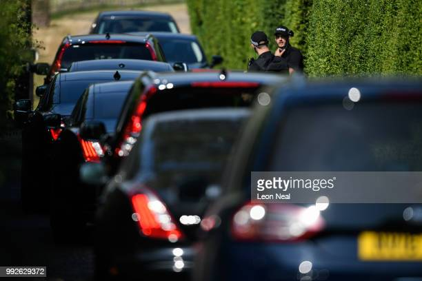 Armed police officers check a queue of ministerial cars as they arrive at the Prime Minister's country retreat Chequers on July 6 2018 in Aylesbury...