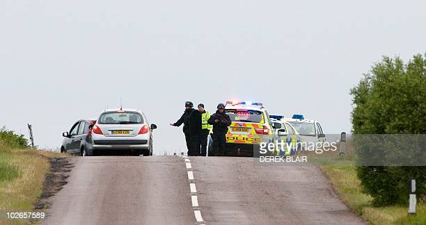 Armed police officers continue their hunt for Raoul Thomas Moat, in Rothbury, northeast England on July 6, 2010. British police said today they were...