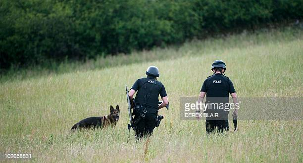 """Armed police officers continue their hunt for Raoul Thomas Moat, in Rothbury, on July 6, 2010. British police said today they were """"closing the net""""..."""