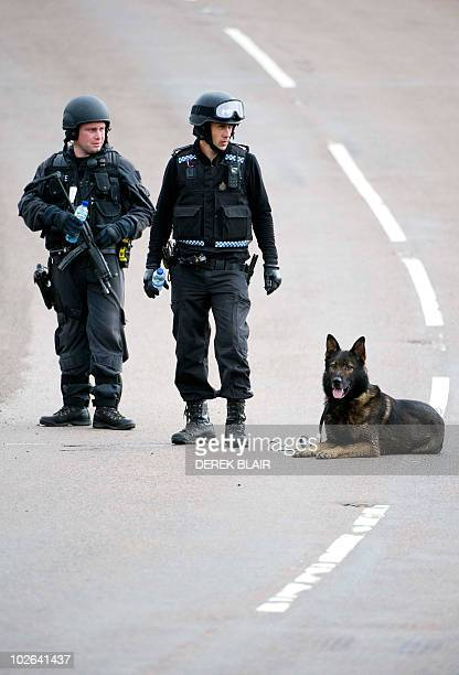 Armed police officers contniue their hunt for Raoul Thomas Moat, in Rothbury, northeast England on July 6, 2010. British police said Tuesday they...