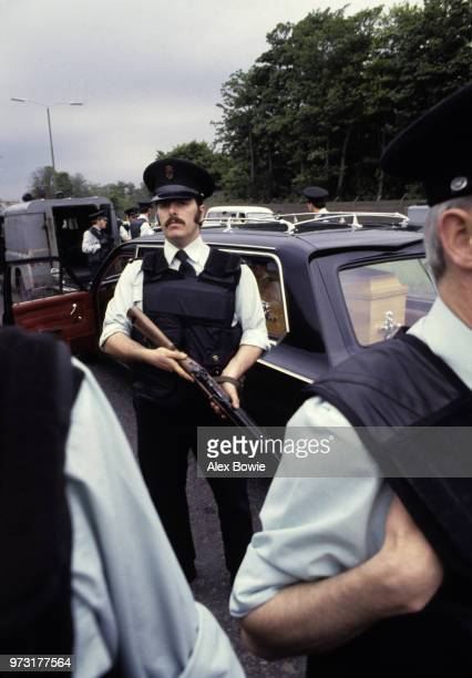 Armed police officers from the Royal Ulster Constabulary invoke the Flags Emblems Act to prevent the funeral cortege of IRA hungerstriker Francis...
